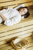 Young woman in the sauna — Stock Photo
