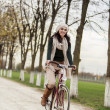 Young womon bicycle — Stock Photo #28870315
