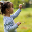 Little girl with dandelion — Stock Photo #30702701