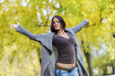 Young woman at autumn forest — Stock Photo