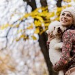 Stock Photo: Young woman with a cute dog
