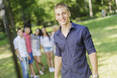 Teenagers in the park — Stock Photo