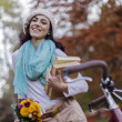 Young woman with a bicycle — Stock Photo