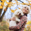 Young woman with a dog — Stock Photo #34034827