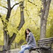 Young woman at autumn park — Stock Photo