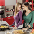 Young women in the kitchen — Stock Photo