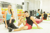 Young man and woman in the gym — Stock Photo