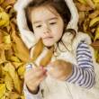 Little girl at the autumn leaves — Stock Photo