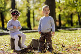 Litle boy and girl at the autumn forest — Stock Photo