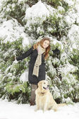Young woman with dog at winter — Stock Photo