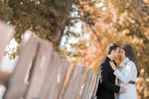 Young couple by the fence — Stock Photo