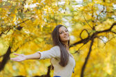 Young woman in the autumn forest — Stock Photo