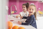 Little girls in the kitchen — Stock Photo