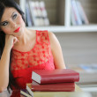 Stock Photo: Young woman with books