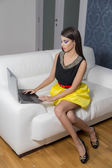 Young woman with laptop in the room — Stock Photo