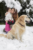Family with a dog at winter — Стоковое фото