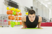 Young man in the gym — Stock Photo