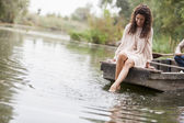 Young woman on the lake — Stock Photo