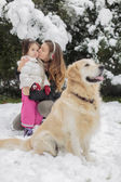 Family with a dog at winter — Foto Stock