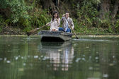 Loving couple in the boat — Stockfoto