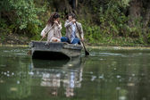 Loving couple in the boat — Stock Photo