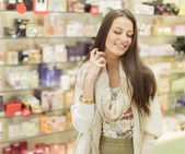 Young woman in perfumery — Stock Photo