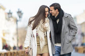 Young couple walking on the street — Stock Photo