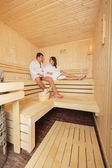 Young couple in the sauna — Stock Photo