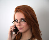 Red hair woman with mobile phone — Stock Photo