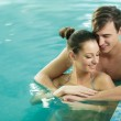 Young couple in the swimming pool — Stock Photo