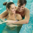 Young couple relaxing in the swimming pool — Stock Photo