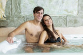 Young couple relaxing in the hot tub — Stock Photo