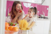 Mother and daughter cooking in the kitchen — Stock Photo