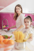Mother and daughter cooking in the kitchen — Foto de Stock
