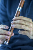 Wooden flute player — Stock Photo