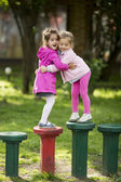 Girls playing in the park — Stock Photo