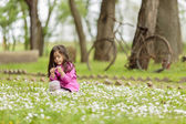 Little girl at the spring field — Stock Photo