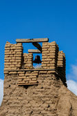 Old belltower from San Geronimo Chapel in Taos Pueblo, USA — Stock Photo