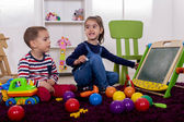 Kids playing in room — Stock Photo