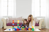 Mother and daughter playing in the room — Stock Photo