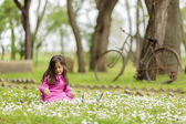 Little girl at the spring field — Foto Stock
