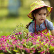 Little girl in the garden — Stock Photo #46491319
