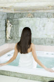 Woman in the hot tub — Stock Photo