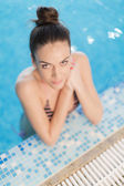 Young woman in the pool — Stock Photo