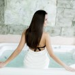 Woman relaxing in the hot tub — Stock Photo #47891569