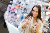 Woman in perfumery — Stock Photo