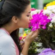Young woman buying flowers — Stock Photo #48584009