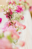 Floral wedding decoration on the table — Stock Photo