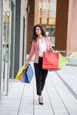Pretty young woman in shopping — Stock Photo