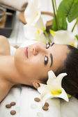Pretty young woman having a massage — Stock Photo